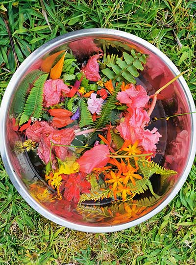 colourful flowers and leaves in a bowl