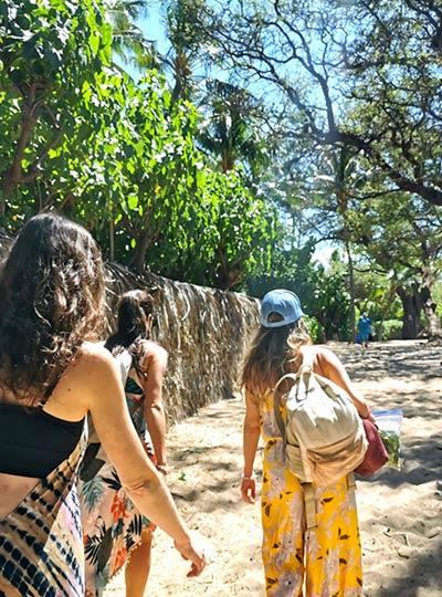 athena naia women walking in hawaii to retreat